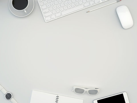 White office desk table with computer, smartphone, supplies and coffee cup. Top view with copy space