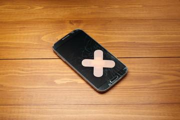 Broken smartphone with bandage