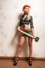 Attractive woman with sledge hammer