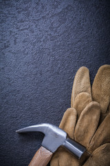 Leather brown working gloves claw hammer construction concept