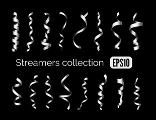 Collection of shiny silver streamers and party ribbons isolated on black