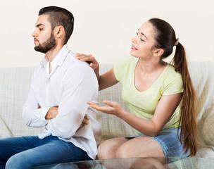 Woman talking to upset man