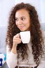 Close up portrait of pretty young women drinking coffee on white background