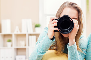 Young female photographer with camera
