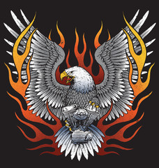 Eagle holding motorcycle engine with flames