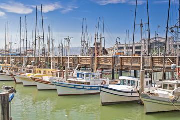 Line of Colorful Sailing Boats at Fishermans Wharf of San-Francisco