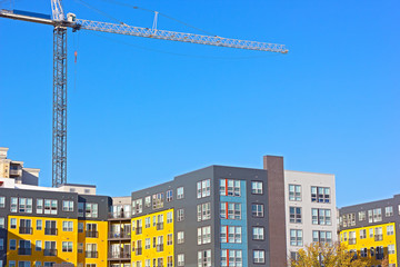 Urban residential development in Northern Virginia, USA. Colorful modern buildings against a clear blue sky in autumn.
