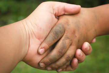 Dirty boy's hand make handshake.