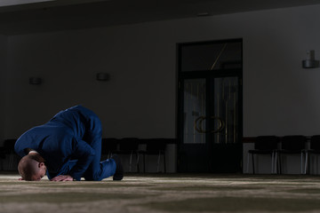 Humble Businessman Muslim Prayer In Mosque