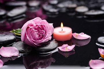 Deurstickers Spa Beautiful pink rose with candle and therapy stones