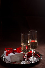 Champagne glasses, gift and  hearts