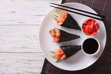 Japanese food: Salmon temaki, ginger and sauce. Horizontal top view