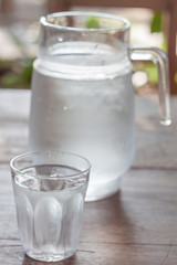 Glass of cold water with jar