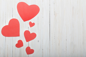 red hearts on old wooden background