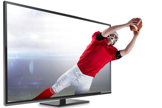 Composite image of american football player catching football