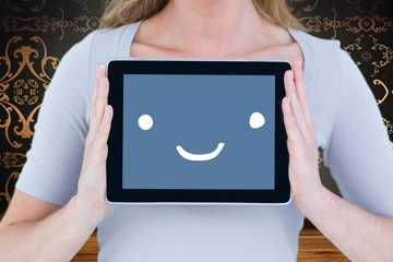 Composite image of portrait of smiling woman with tablet