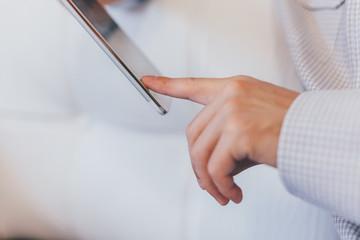 Closeup of Man Touching Tablet