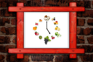 Wooden frame against a brick wall with clock arranged from healt