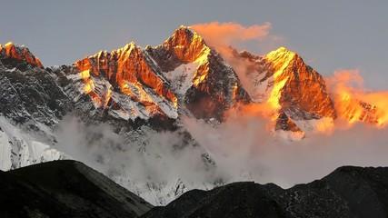 Fototapeta golden snow mountain sunset in the Himalayas obraz