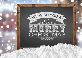 We Wish You A Merry Christmas on blackboard with blurr city and