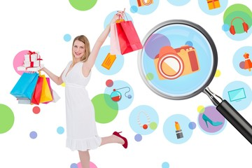 Composite image of elegant blonde with shopping bags and gifts