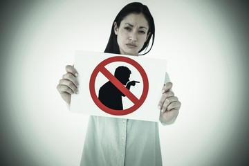 Composite image of sad woman showing sign
