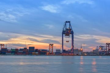 Sunrise behind of cargo ship terminal.