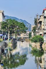 Waterway with bridge in old traditional neighborhood, Wenzhou, Zhejiang Province, China
