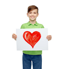 happy boy holding drawing or picture of red heart