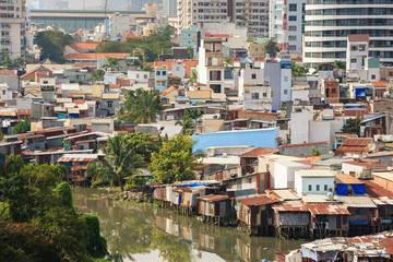 Colorful squatter shacks and houses in a Slum Urban Area in early morning, Ho Chi Minh City, Vietnam