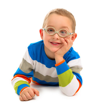 Portrait of cute smiling boy with glasses on a white background