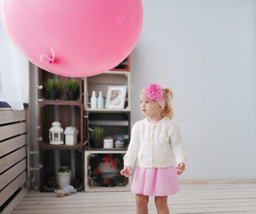 little girl and air pink sphere