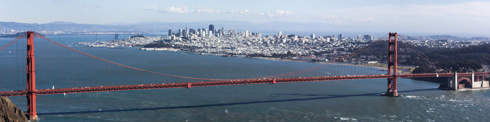 Golden Gate bridge seen from Marin County, with view of San Francisco across the bay on a clear winter's day.