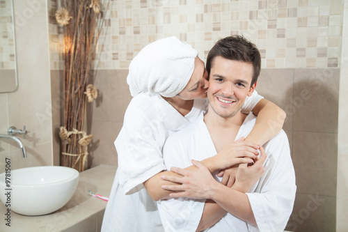 Man Kissing His Woman In Bathroom