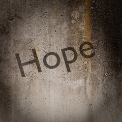 Word 'Hope' on grunge wall
