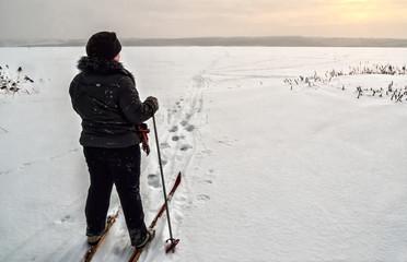 Skier in a snowy field