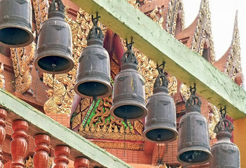 Buddhist bells/Buddhist bells hanging in thai temple.