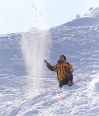 man throws snow in the winter