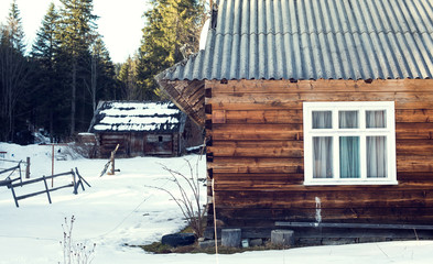 wooden house in winter forest, Mountains