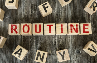 Wooden Blocks with the text: Routine