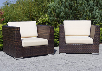 Outdoor furniture rattan armchairs on terrace