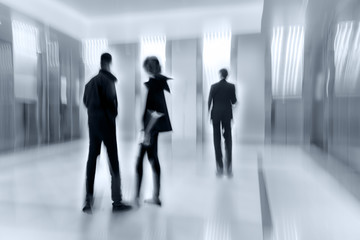 group of people in the lobby business center and blue tonality
