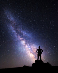 Milky Way. Night sky and silhouette of a man