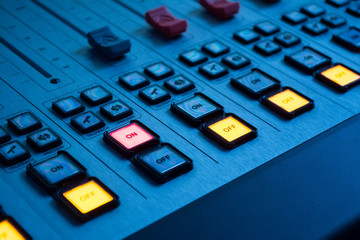 Sound mixer with burning red button on