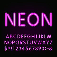Neon Light Alphabet Font. Type letters, numbers and symbols. Purple neon tube letters on the dark background. Vector typeface for labels, titles, posters etc.