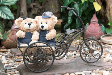 two teddy bears on garden background