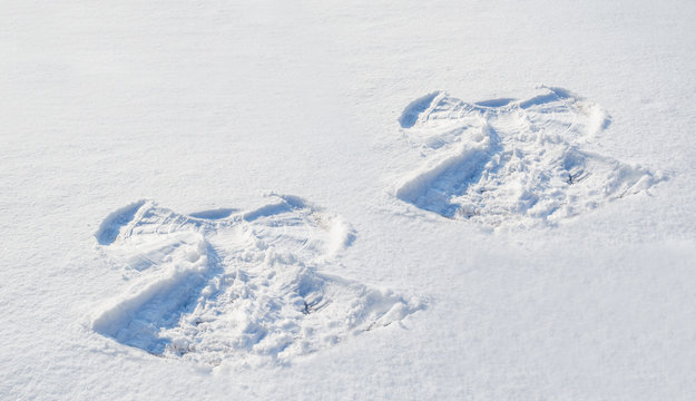 Two figures in the snow angel
