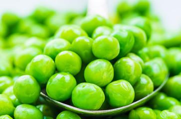 Fresh peas macro, green background.