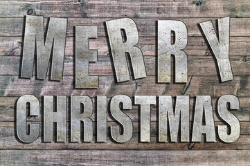 Iron Merry Christmas written on wooden board