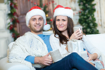Merry Christmas and Happy New Year. Couple in love is sitting in